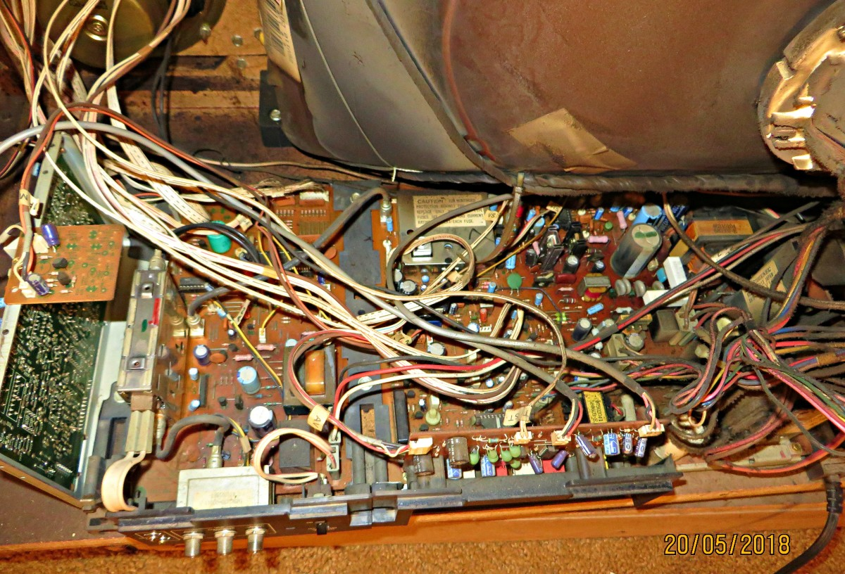 The 1985 Curtis Mathes Color Console, Model K2658RL, with the amazing made in America A66AbU30X CRT picture tube. The integrated circuit boards to keep this CRT bright & beautiful since 1985 are amazing.