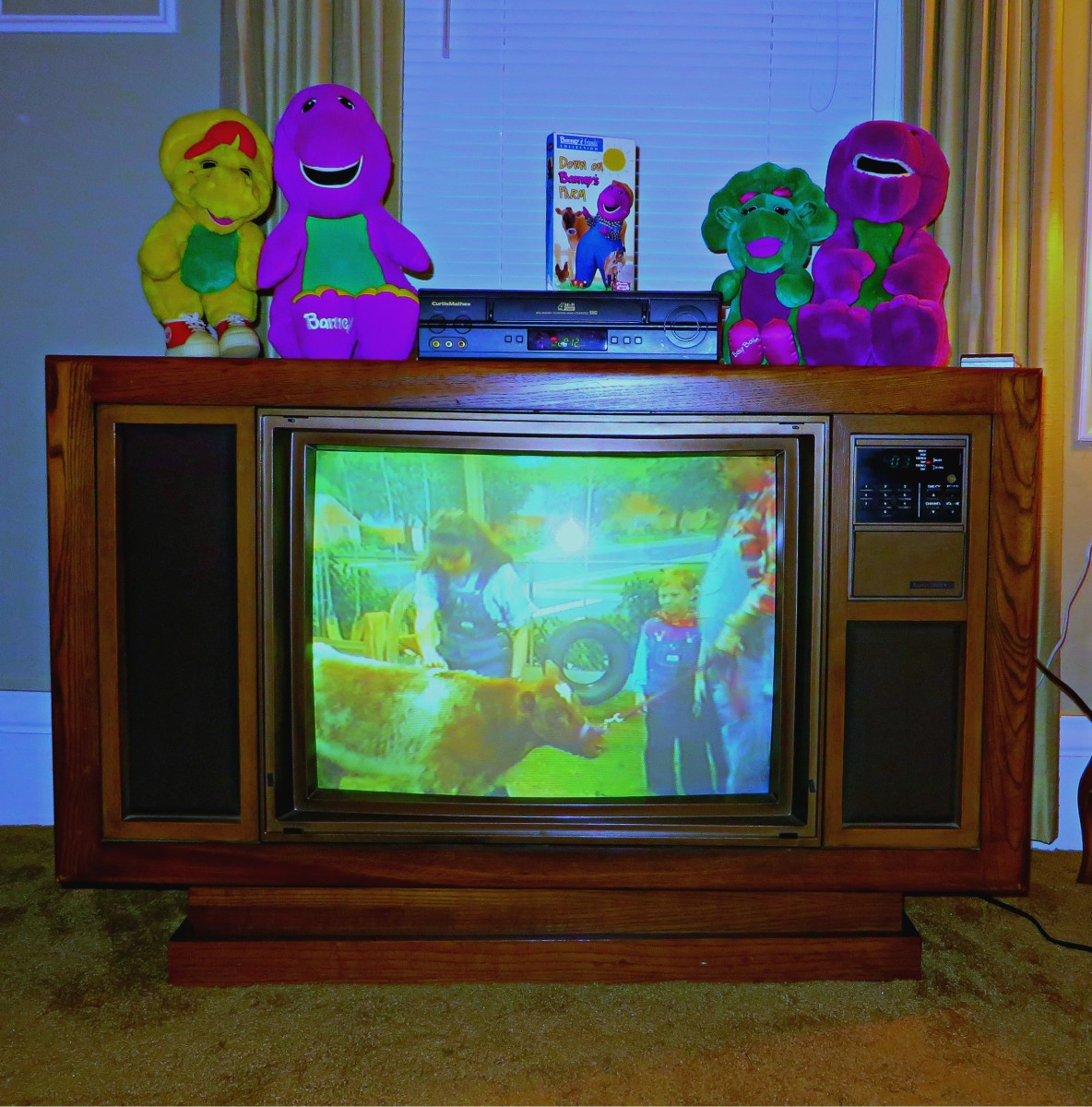 The 1985 Curtis Mathes Color Console Playing a Barney Home Video VHS tape from a Curtis Mathes VCR tape player in the year 2018, vintage fun for the whole family to enjoy over and over again.