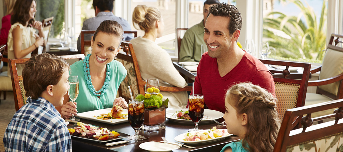 Family eating out at restaurant