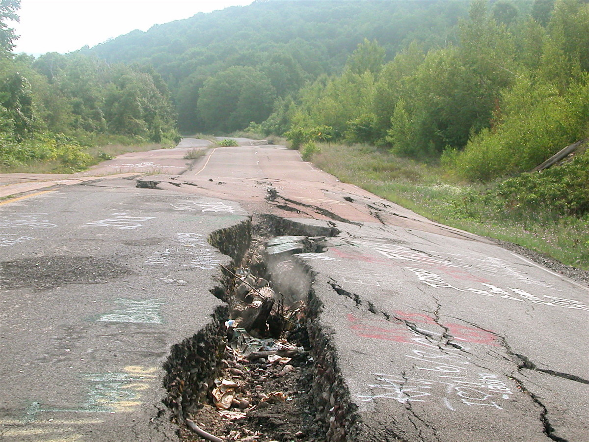 Smoke emanating from a fissure in the road on the abandoned section of highway 61 near Centralia, PA. An underground mine fire has been burning there since 1962.
