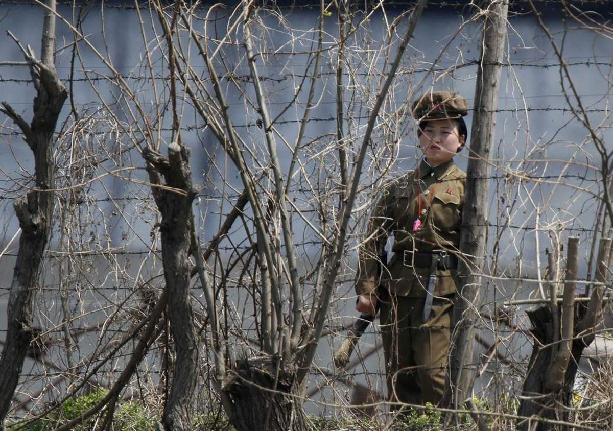 A North Korean guard stands watch over a concentration camp that does not officially exist.