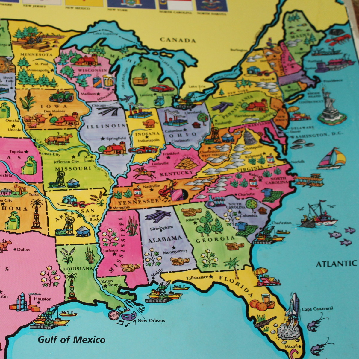 """Pointing out the 13 Original Colonies on the US map from the book atlas, """"It's a Big, Big World."""""""