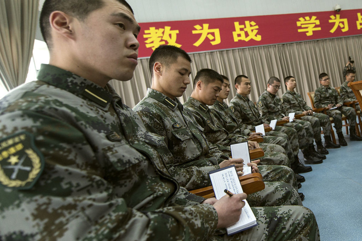 Chinese soldiers doing lectures.