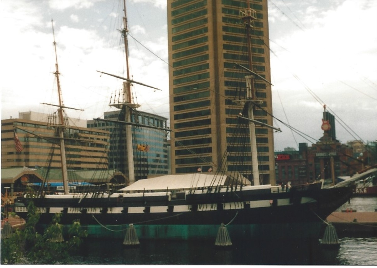 The USS Constellation, foreground, The World Trade Center in Baltimore, the Pratt Street Pavilion in the background.