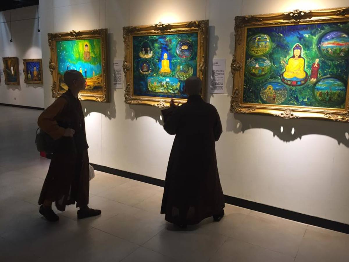 Monks discussing about the painting