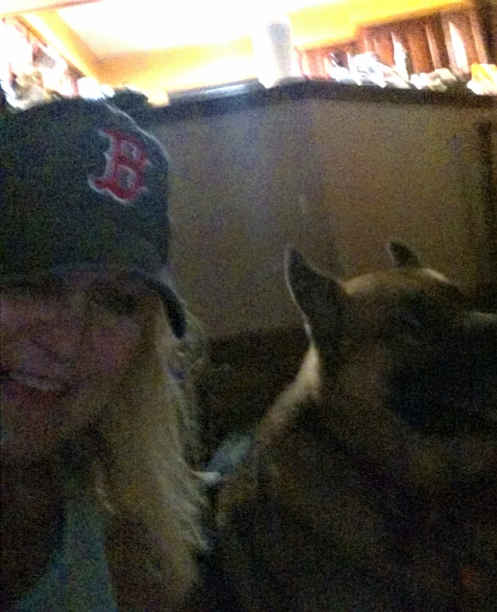 My dog is mad at me because these late night games keep US up til the wee hours of the morning. He is so dramatic; yawning, whimpering, grumbling, whining.....LOL He even looked away when I tried to take our picture....Sorry Gunner! Go Red Sox!!!