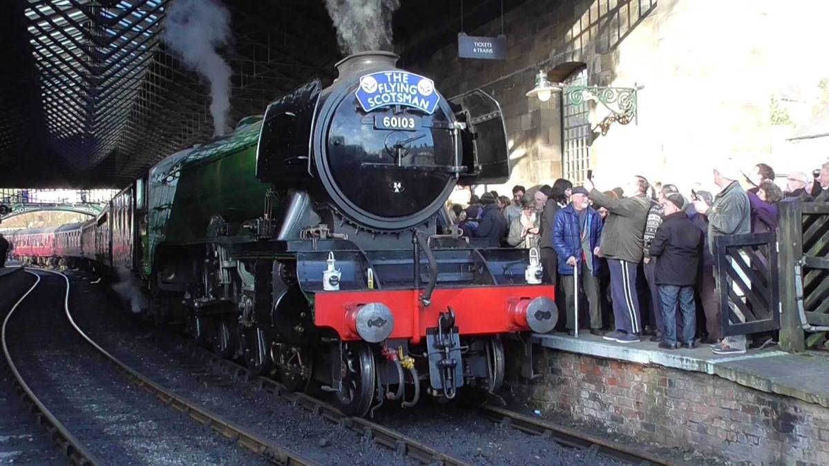 'Flying Scotsman', 60103 to friends, arrives at Pickering in March 2016 with a crowd of eager onlookers on and around the platform