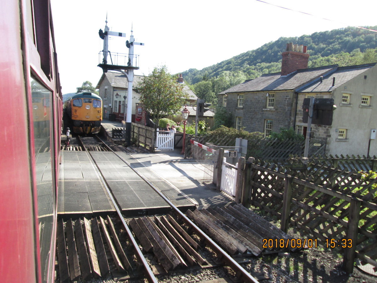 Arrival at Levisham with a diesel-headed 'down' working waiting in the loop
