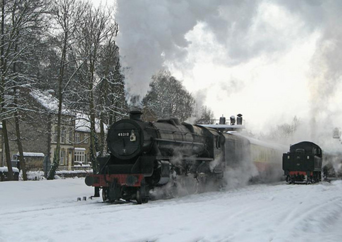 The scene looks right, sort of... Since when did Santa arrive driving an ex-LMS Class 5? What happened to faithful old Rudolph? He's in the brake van? Oh, that's all right then