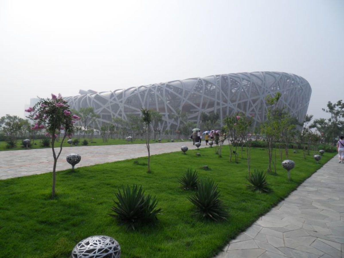 "A combination of fog and pollution slightly shroud the ""Birds Nest"" National Stadium."