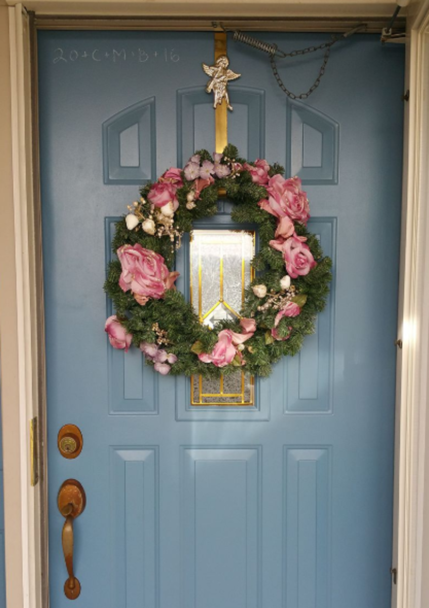 The top-left of this door is marked with chalk, wishing for blessings on the house.