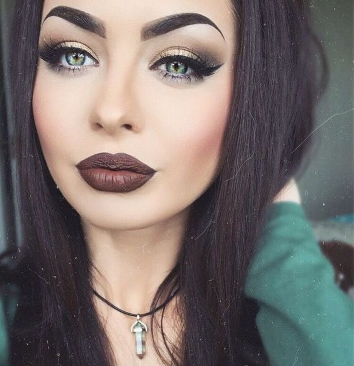 Seemingly a Very Good-Looking Woman Using Heavy Makeup