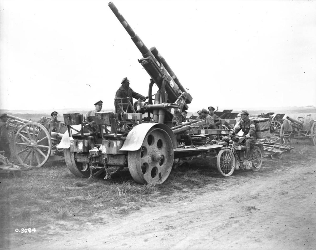 In the First World War British troops with a German 88mm Flak gun originally designed by Krupp as an anti-balloon gun.