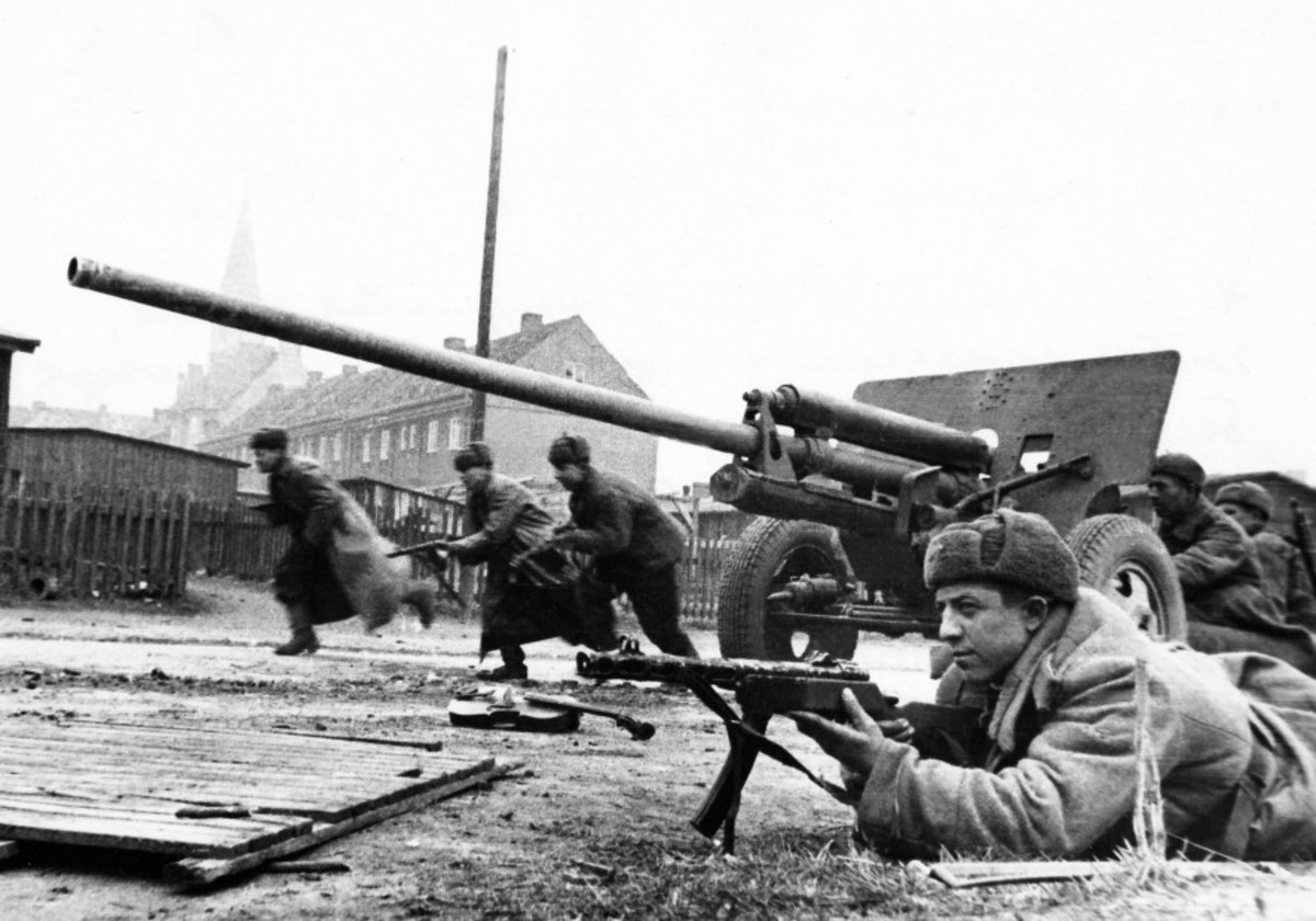 Russian 76mm anti-tank gun in action supported by Red Army troops. It fired a deadly fifteen-pound shell. Rommel would push these guns right up to the front line knocking out British tanks.