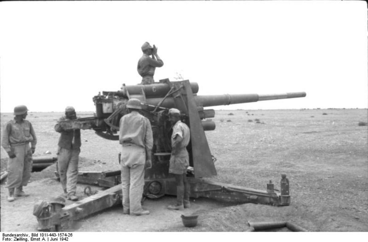 88mm anti-tank gun in position at Bir Hakeim, North Africa, June 1942. Rommel would screen his minefields with his deadly 88mm guns decimating enemy tank divisions as they tried to break his line of defense.