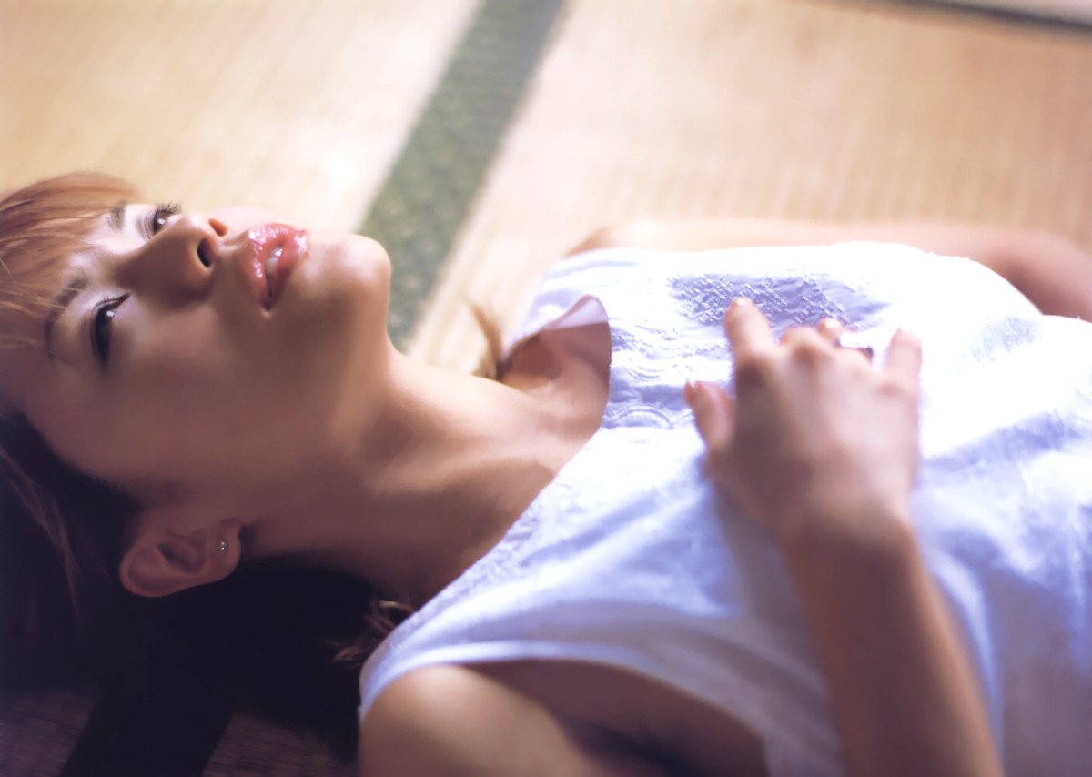 Is Yuko Nakazawa meditating in this photo? At the very least she is trying to relax herself and show her softer side.