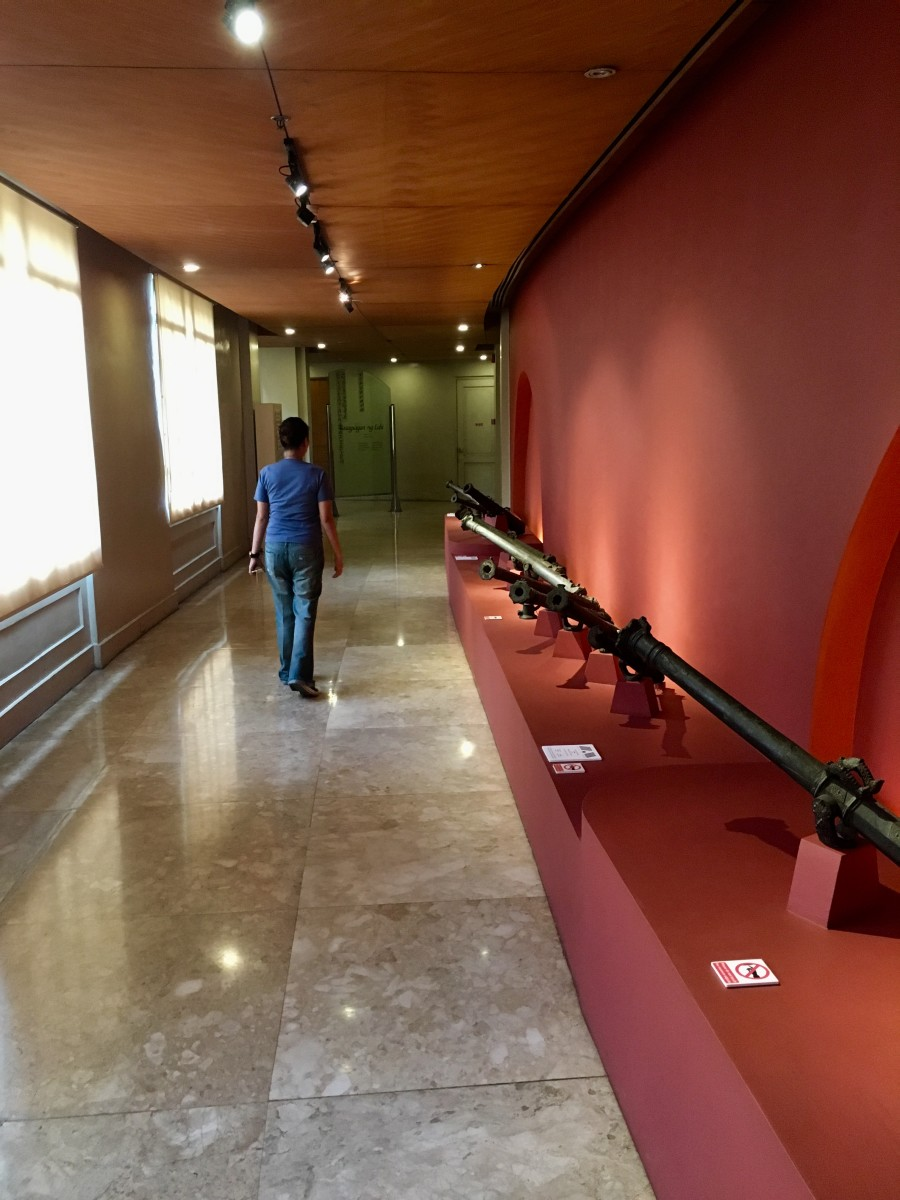 Me walking along the corridors with the items displayed at Lantaka of War and Peace