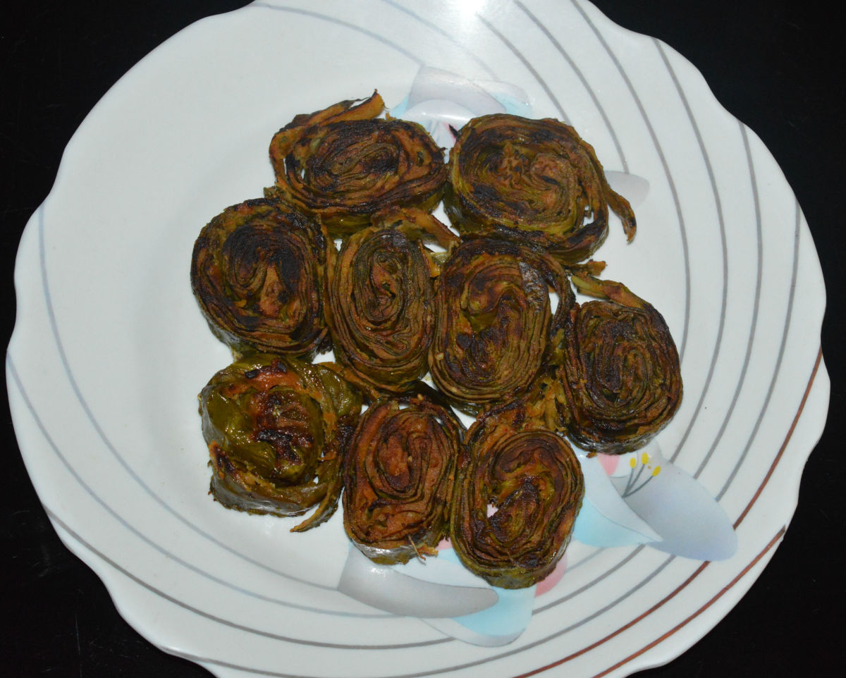 Shallow fried taro leaf rolls. Relish these delectable snacks!