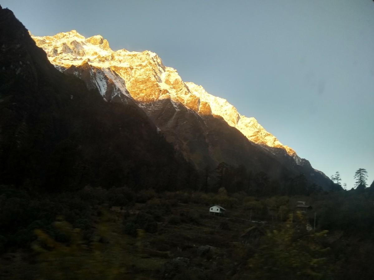 The sun kissing the snowy peaks