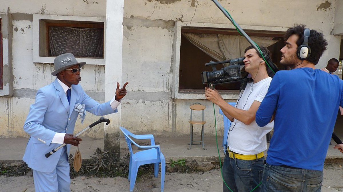 Sapeurs love publicity; here a member of the stylish community in Brazzaville is interviewed by Spanish television.