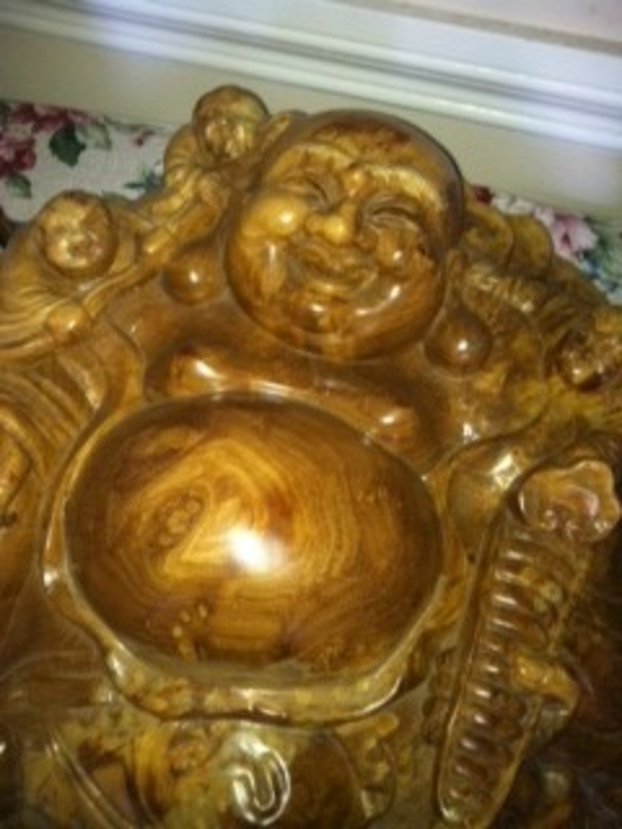 I love the Buddha belly and the wonderful wood. So Buddhists are welcome here.