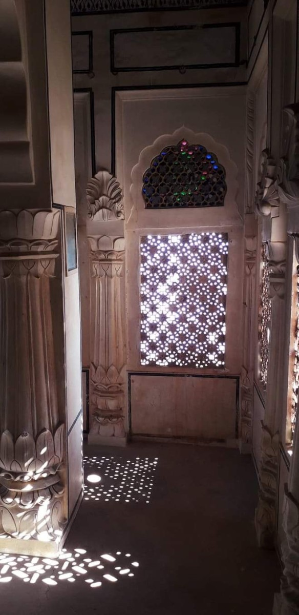 The Jharokha or the window, from where the queen used to see the proceedings of the Royal court rooms. Since those were the times, when there was purdah system.