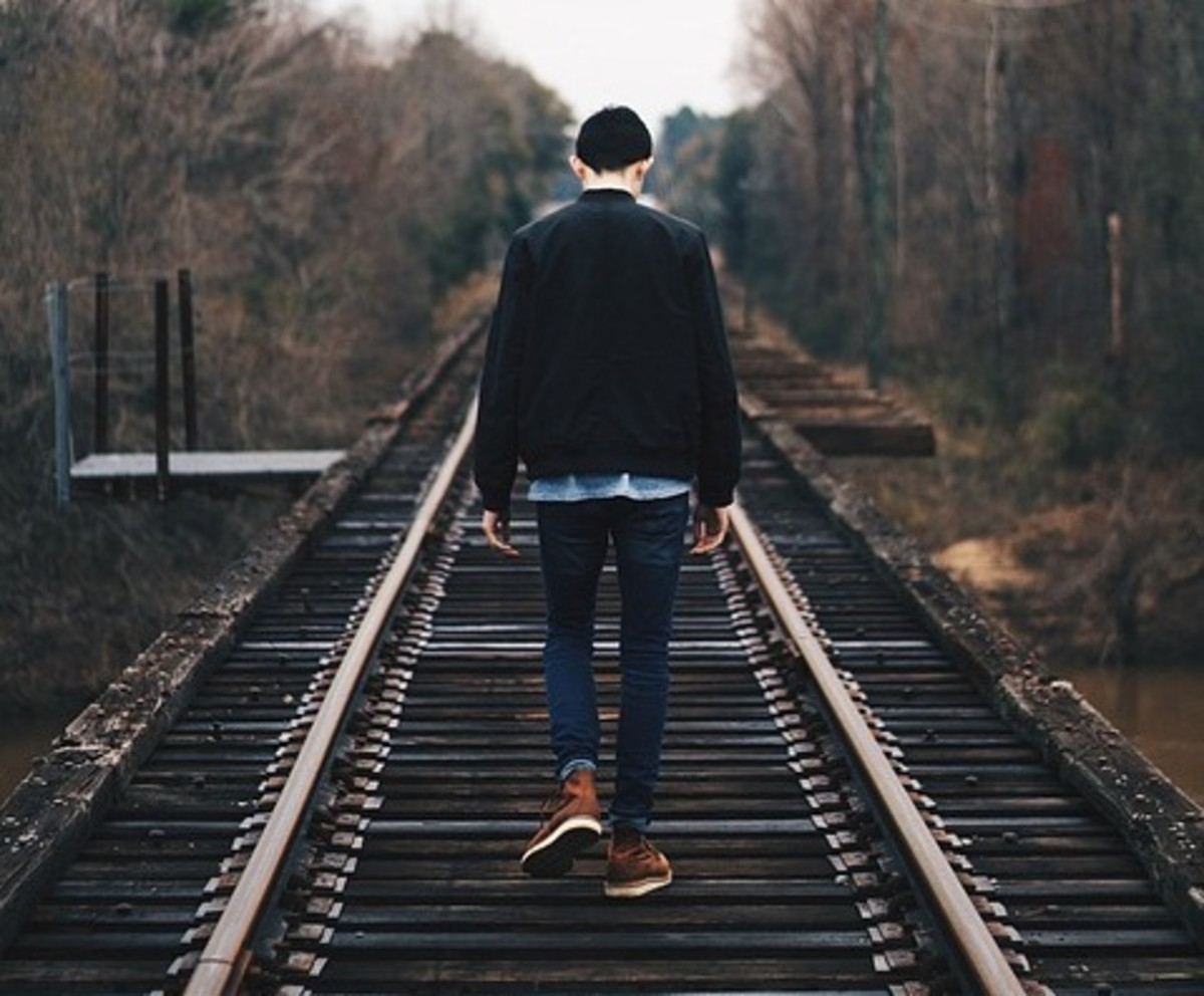 Man walking on a railway track