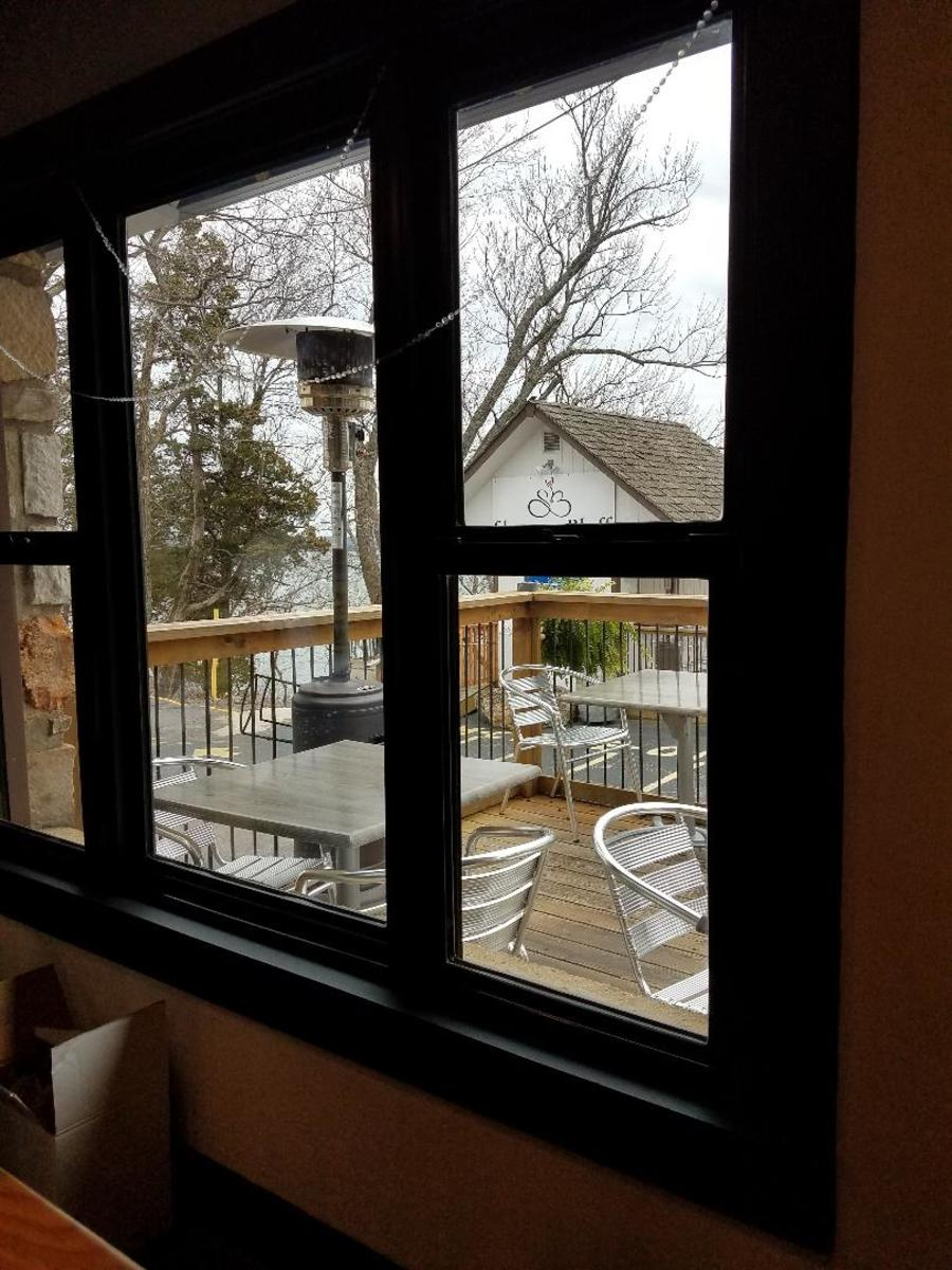 A fall day inside the bar looking out. The outdoor bar is in view but closed for the season.