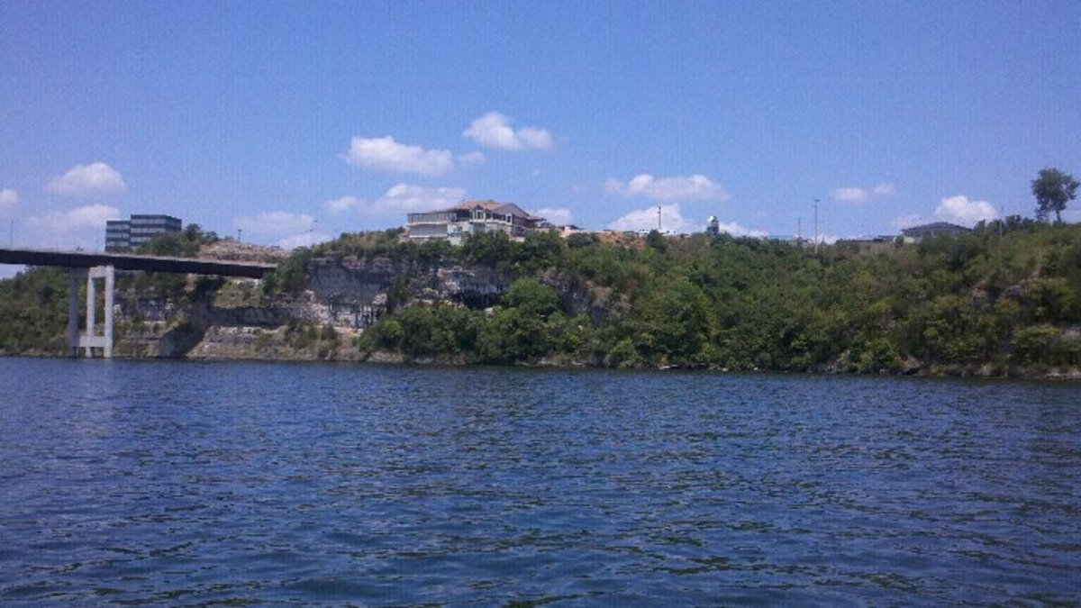 Boat-view of the bluffs where the winery is located. The large white building is JB Hooks, a popular restaurant. The winery is to the right but unable to be seen.