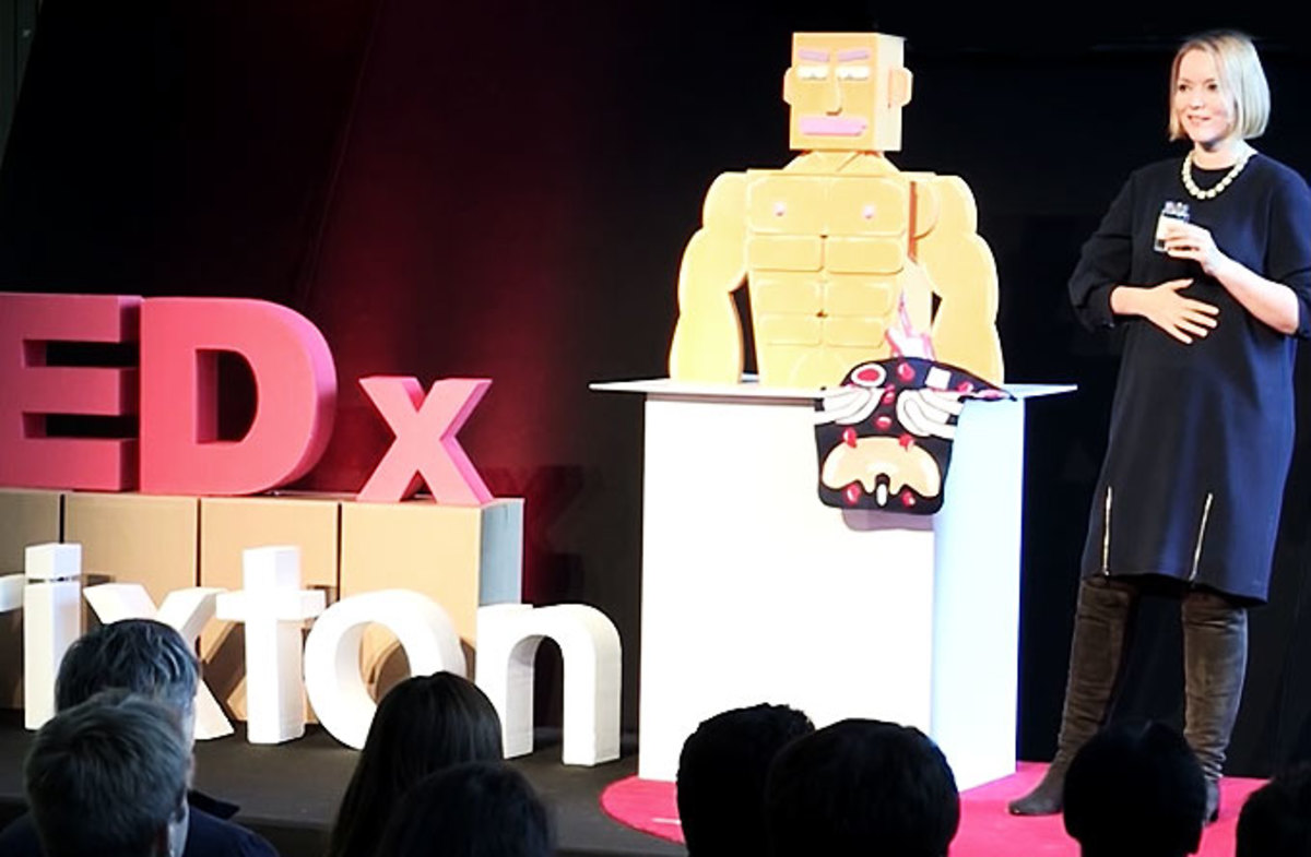 Caroline Goyder using chest of drawers as a prop to explain her topic at TEDxBrixton