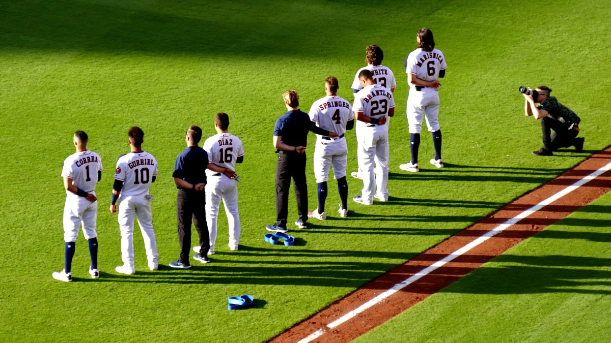A view of some of the Houston Astros players on the field including Carlos Correa who is pictured on the far left.