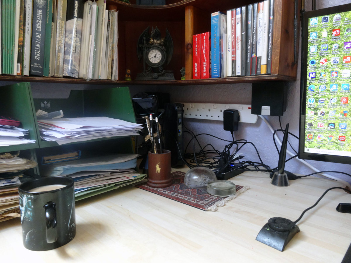 Most of the computer equipment relocated to storage under the desk, to make space for additional filling trays.   New six-gang extension lead wall mounted above desk, with four-port USB hub plugged in