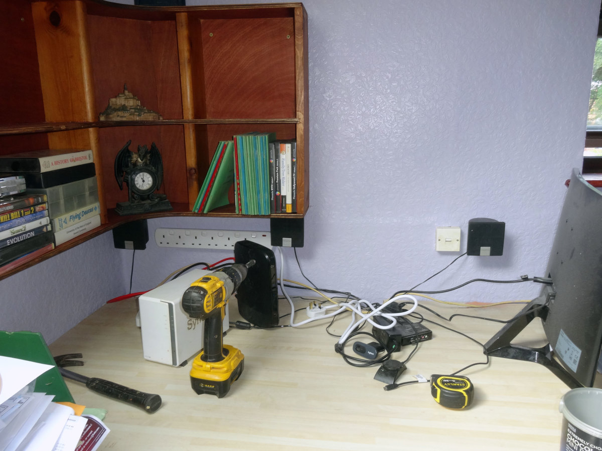 Front speakers fixed to wall at back of  desk, as part of the makeover
