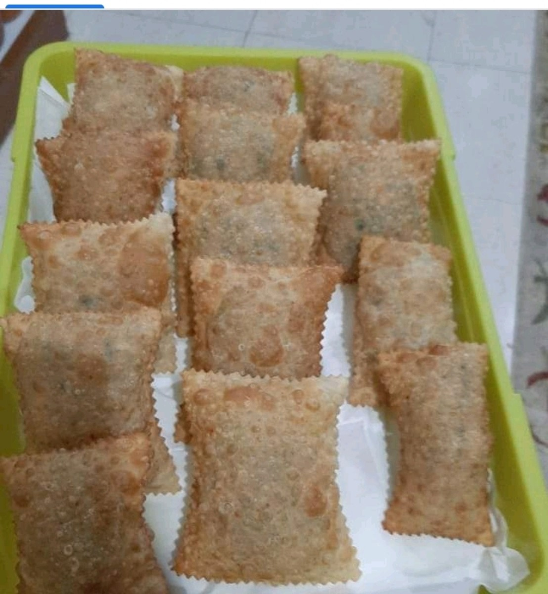 An afternoon samosa snack. A combination of meat,green onions and flour as the main ingredients.