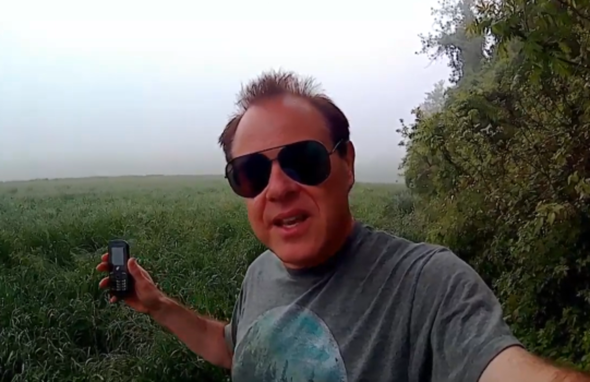 Gary using his Tracfone in a field to capture EVPs from spirits or other interdimensional beings