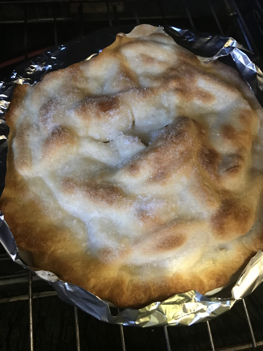 Bake for 20 minutes, then cover the edges of the crust with strips of foil to prevent them from becoming too dark. Bake for an additional 25 minutes.