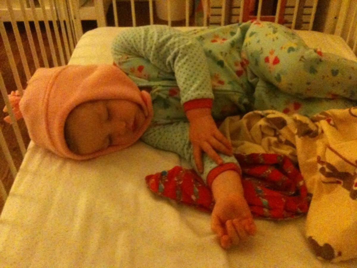 She does most of the damage to her hair while sleeping, so now we put a hat on her for treatment.