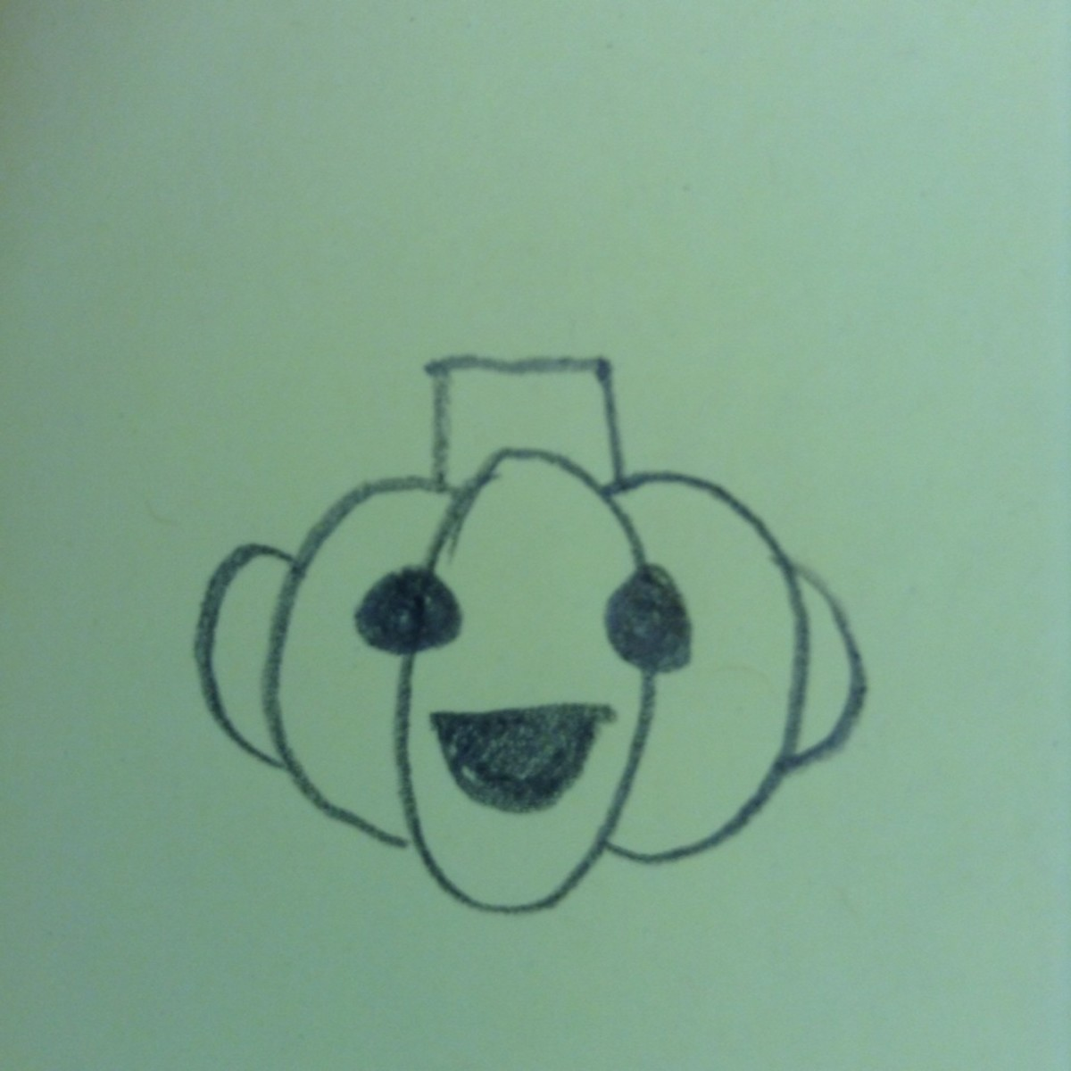 Use shapes to draw a Jack O' Lantern face.