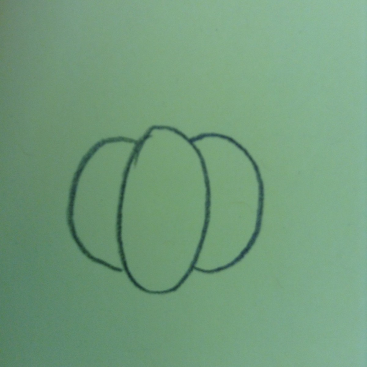 Add two curved lines on either side that are shorter than the oval.