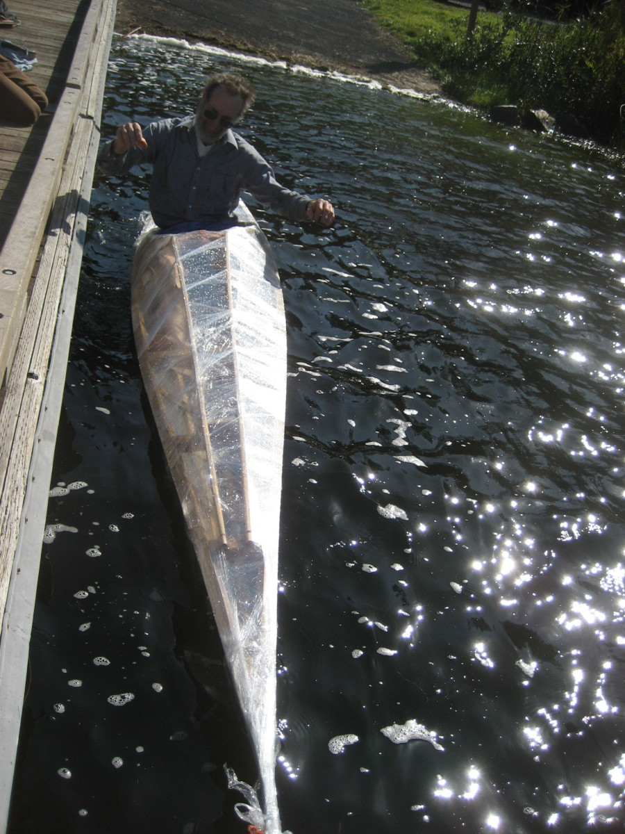 Builder testing his Greenland kayak - hip-wiggle to test balance/secondary stability.  This authentic Greenland kayak is a low-profile hunter's kayak, 'tippy' for beginners but lighweight and responsive for an expert paddler.
