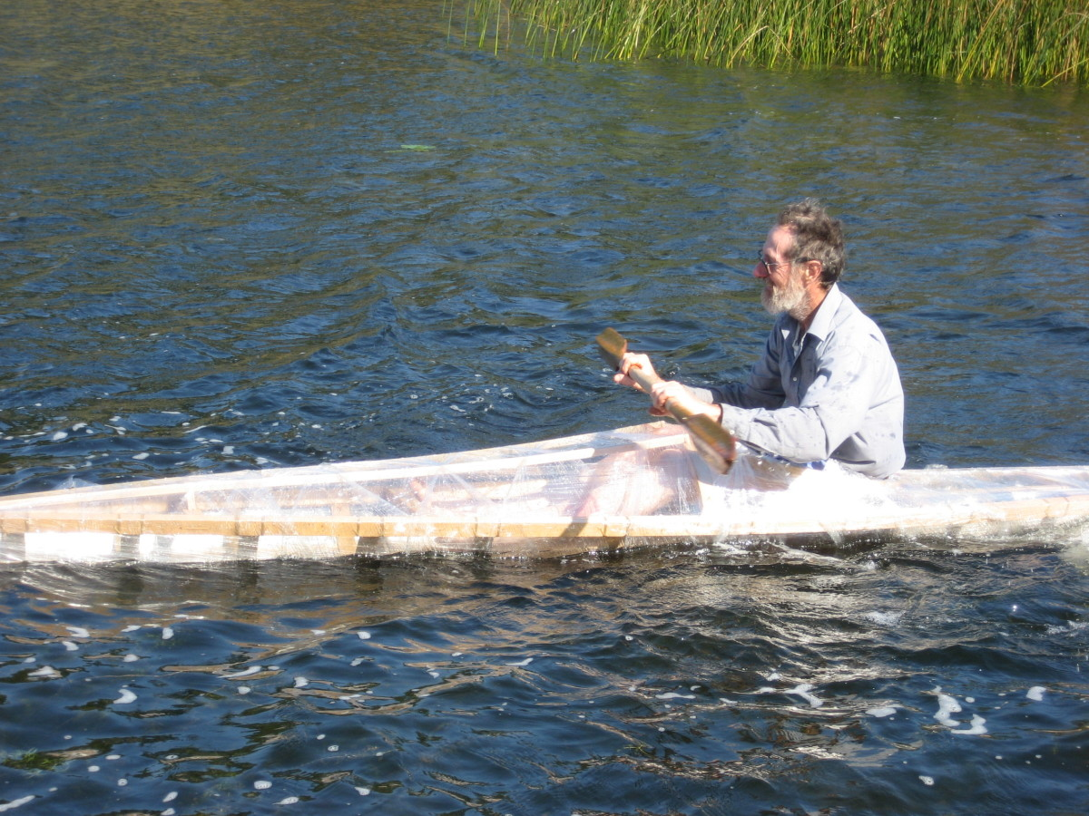 Builder testing his first home-built Greenland kayak - balance check