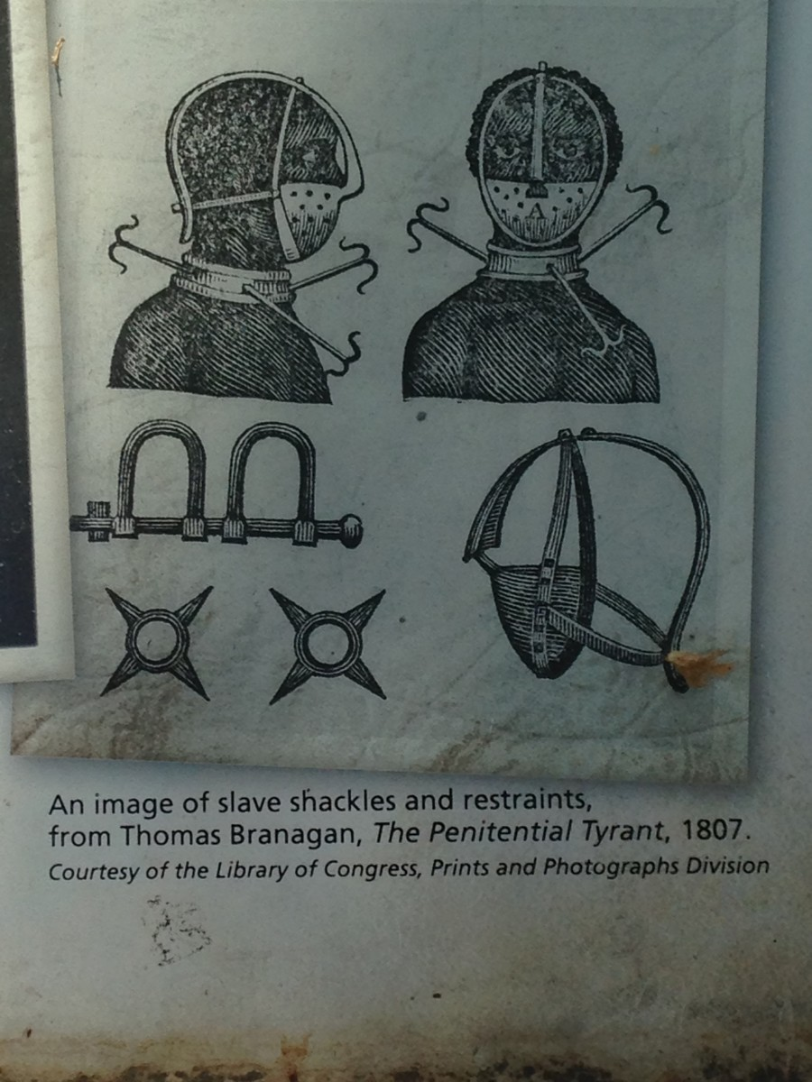 WHO SAID WHITES DIDN'T GIVE BLACKS ANYTHING; ACCOUTREMENTS USED TO SHACKLE BLACKS DURING TRANSPORT TO MARKET.
