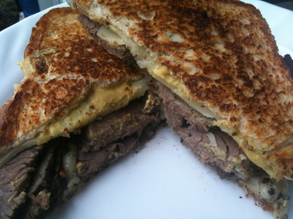 An ultimate pastrami sandwich - a little mustard, a little provolone, on toasted whole wheat.