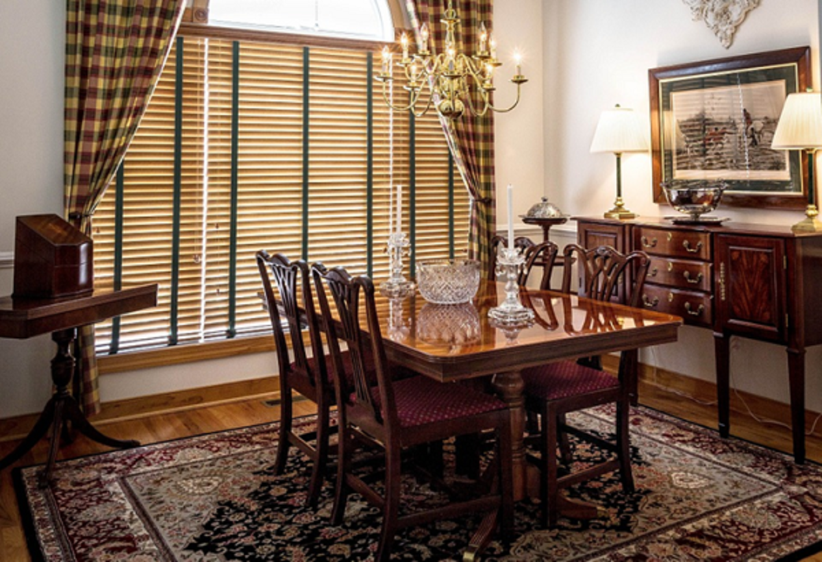 Bamboo window blinds in a classic interior design setting. These window blinds can be installed on both windows and glazed doors as is seen in this picture..