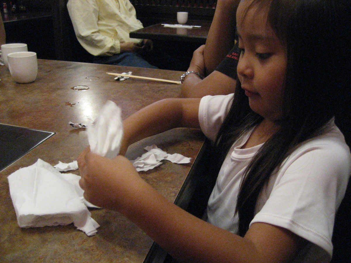 My daughter found great joy working on a paper-tearing story while waiting at a restaurant.