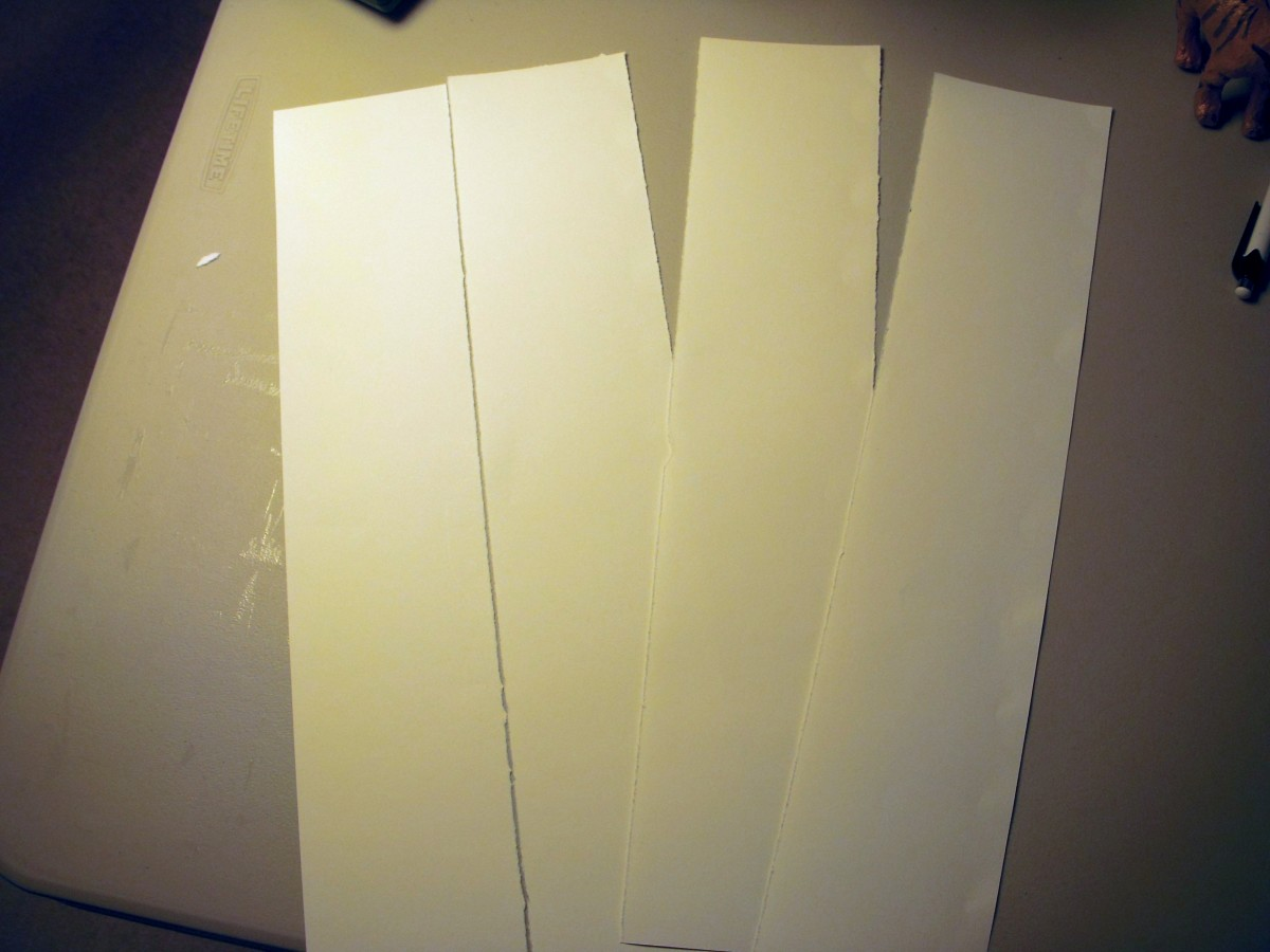 """Tear or cut 4 sections, each measuring 3.5""""x17""""."""