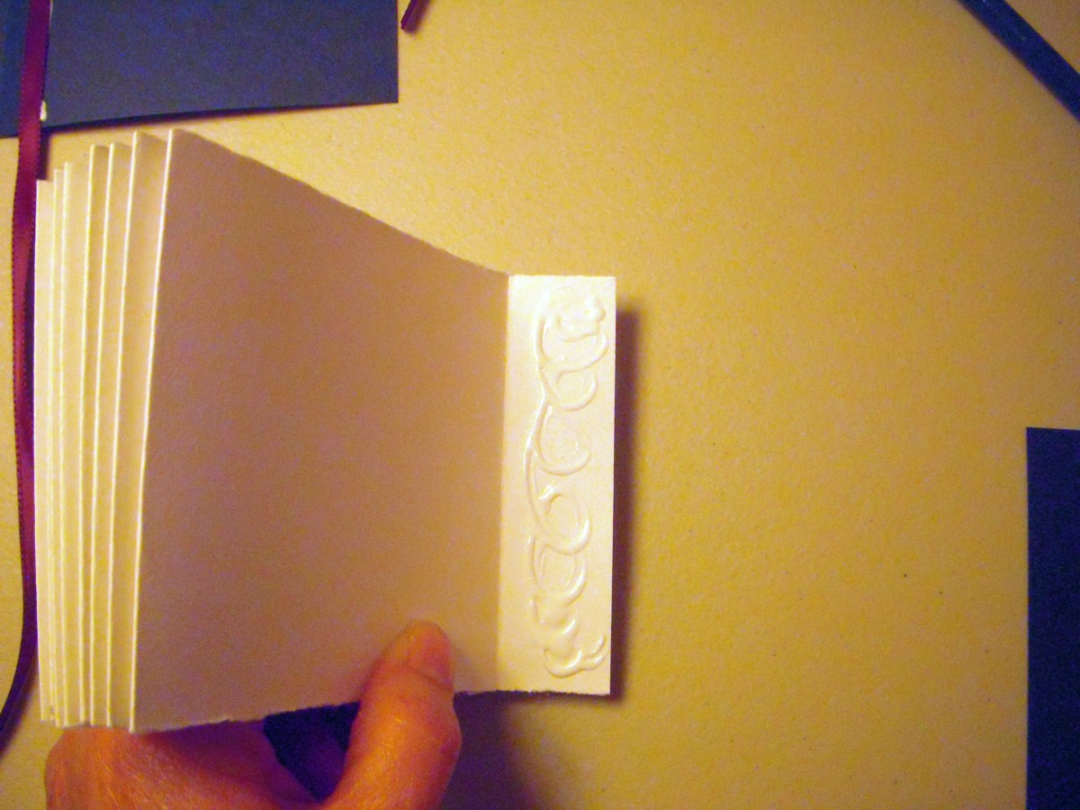 Glue the back page to the remaining tab on your long accordian-folded strip.