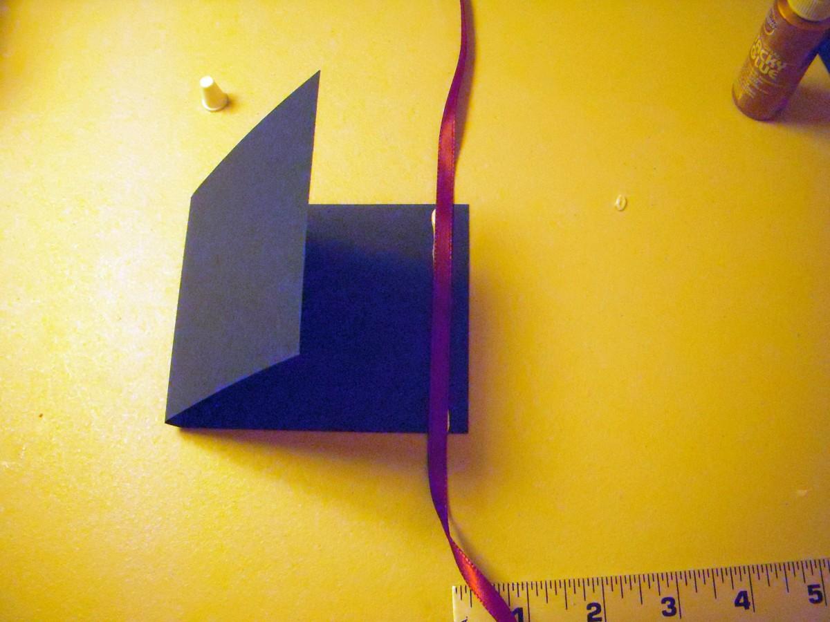 Center ribbon and press into glue.