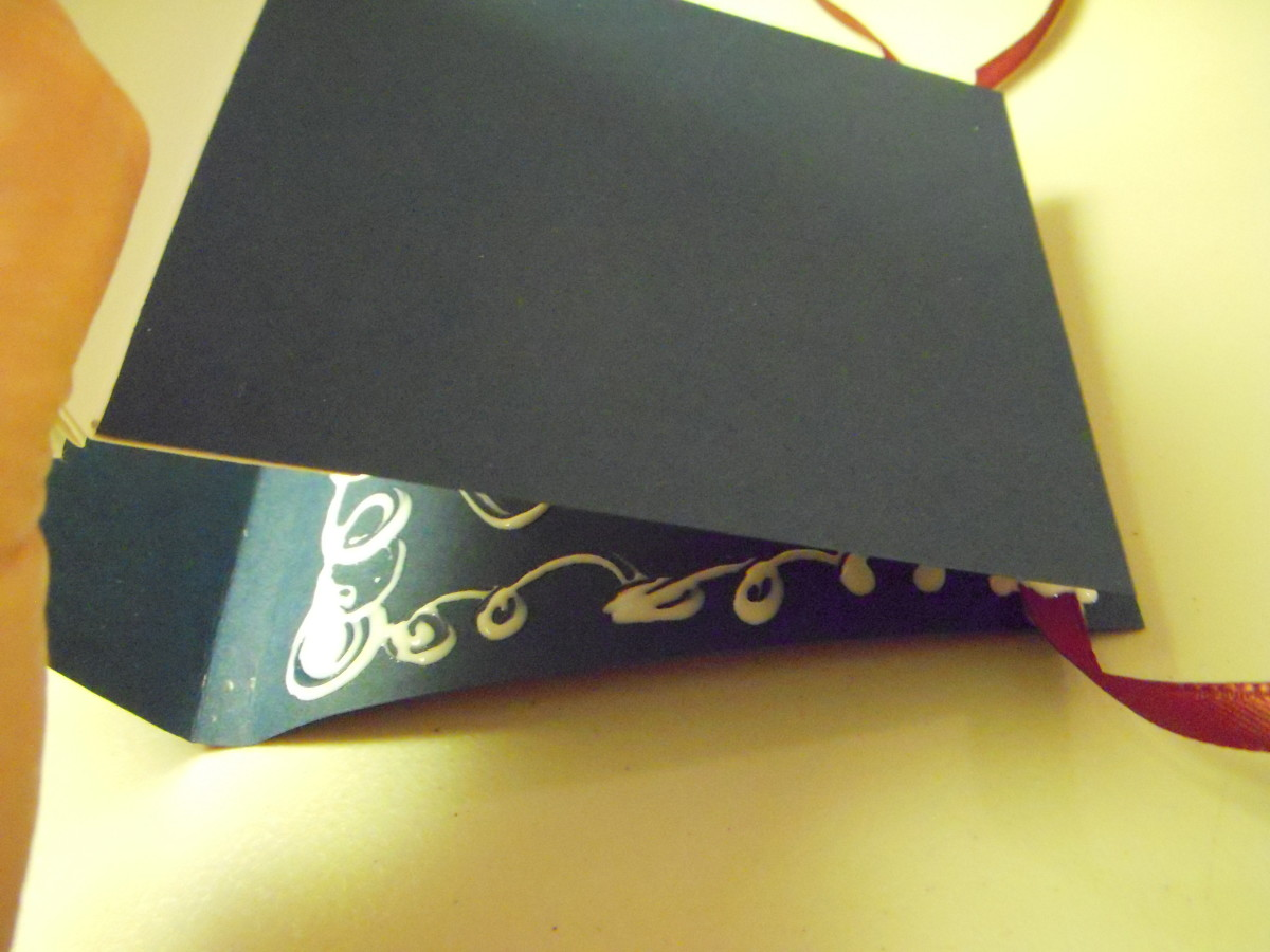 Attach the pages to the cover by laying the back page to the cover.