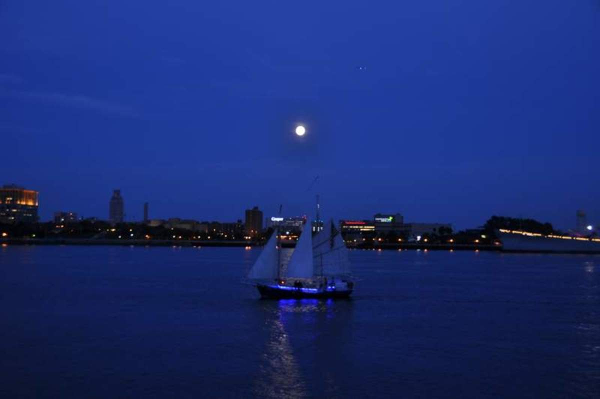 Sailing under a full moon past Penn's Landing in Philadelphia.